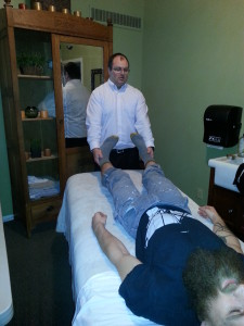 Dr Whitaker performing Osteopathic Manipulation